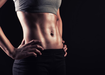 Strong woman abs show off