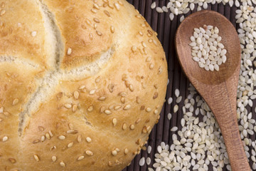 Sesame bread with sesame seed in wooden spoon