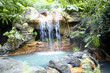 Little pool with a waterfall and hot thermal water, Costa Rica - 67343811