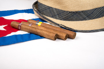 cuban cigar and hat