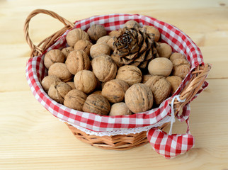 Basket with nuts on a wooden table.
