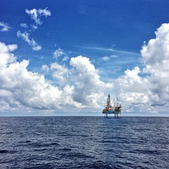 Oil jack up rig with a dramatic cloud