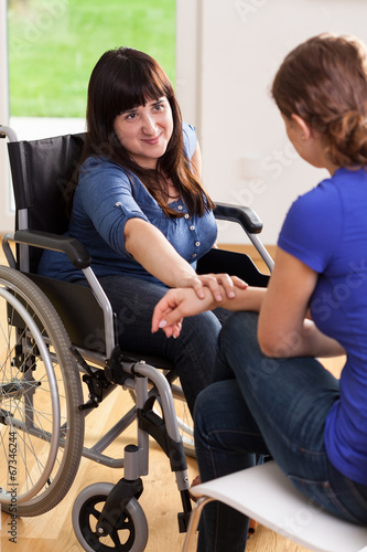canvas print picture Girl on wheelchair talking with female friend