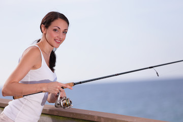 Woman fishing and smiling