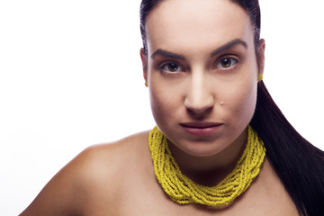 Beauty Close up Portrait of Young Female with Yellow Necklace