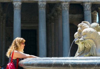 Young female tourist at the fountain in front of Pantheon, Rome