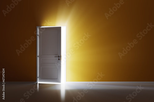 Rays of light through the open white door on orange wall - 67347634