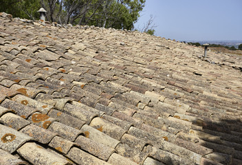 Italy, Sicily, old shingles on the roof of a stone house
