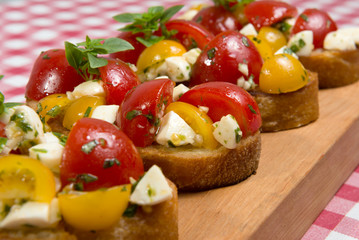 Bruschetta with tomatoes and mozzarella cheese