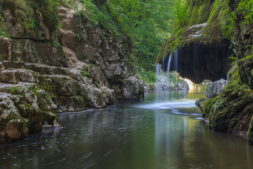 Bigar Cascade Falls in Beusnita Gorges National Park, Romania