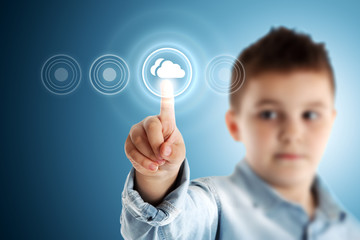 Cloudy. Boy pressing a virtual touch screen. Blue background.