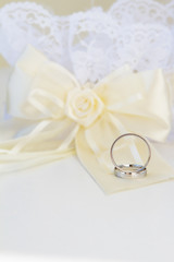 wedding rings and decoration over white