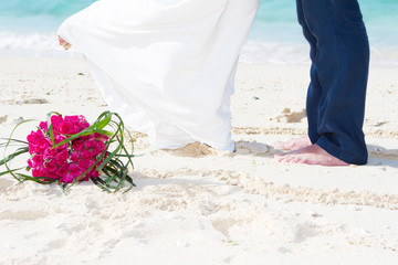 wedding on tropical beach, bride and groom