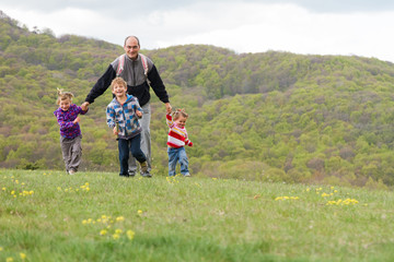 happy family with three kids enjoying free time on natural backg