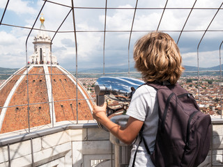 Tourism concept: Boy looking at the Dome of Florence, Italy.