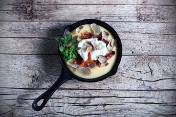Porridge cornmeal polenta, poached egg and truffles