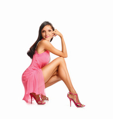 Brunette woman in pink dress. Fashion photo