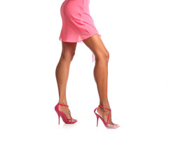 Closeup picture of woman in pink dress on high heels