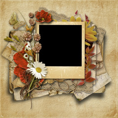 Vintage background with old frame and beautiful flowers