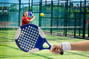 women playing paddle tennis