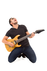 hispanic young man playing electric guitar