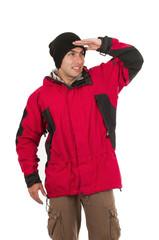 young man wearing red winter coat posing looking at something