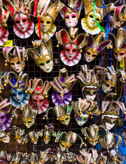 Venetian masks in store display in Venice.