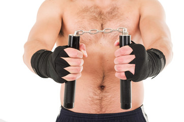 martial arts fighter holding black nunchucks with his hands