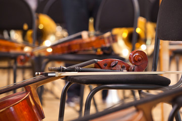 Fingerboard cello lying on a chair on stage closeup