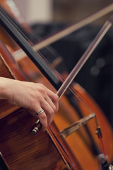 Hand girl playing cello closeup