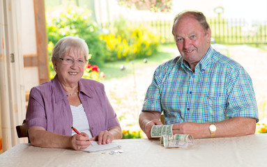 older couple calculating her budget
