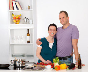 man and woman together in thekitchen