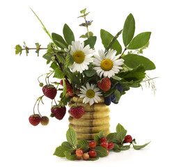 Summer flowers and berries in vase