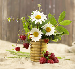 Summer flowers with strawberry in vase