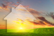 Vision of a new house on green field at sunset. Real estate
