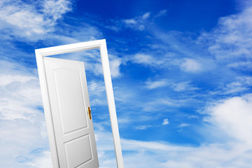 Open door on blue sunny sky. New life, success, hope.