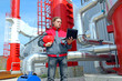 Industrial worker with notebook working in power plant