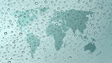 world map on glass with water drops