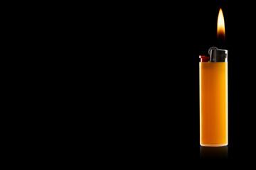 colored lighter on a black background
