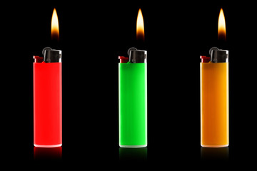 colored lighters on a black background
