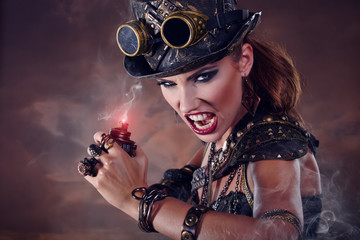 Portrait of a beautiful steampunk woman over smoke background.