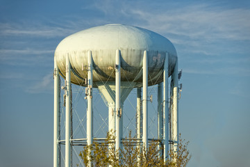 A water tower in the deep blue sky