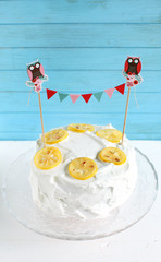 Lemon cake with lemon meringue icing and candied lemons