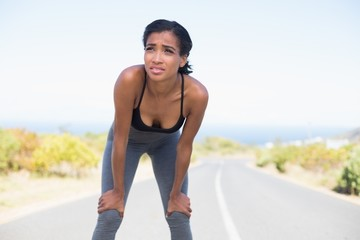 Fit woman taking a break on the open road