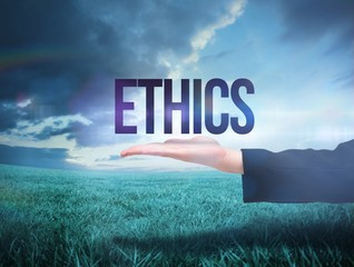Businesswomans hand presenting the word ethics