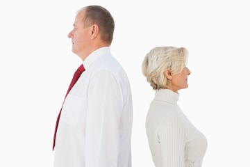 Older couple standing not facing each other