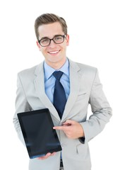 Geeky businessman pointing to tablet pc