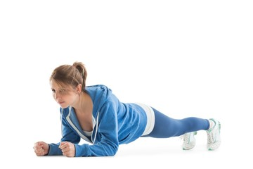 Young woman in basic plank posture