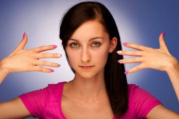 girl with beautiful nails over blue background