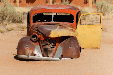 Old car wreck lying in the desert